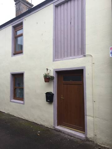 The house is situated in a quiet lane which runs between Savers and Village Greenery