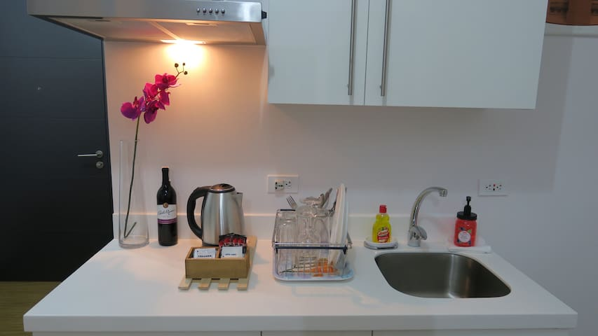 Kitchen w/ Complimentary coffee. Red wine not included.
