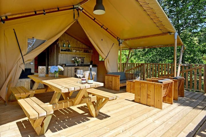 A luxury glamping tent nearby a beautiful lake