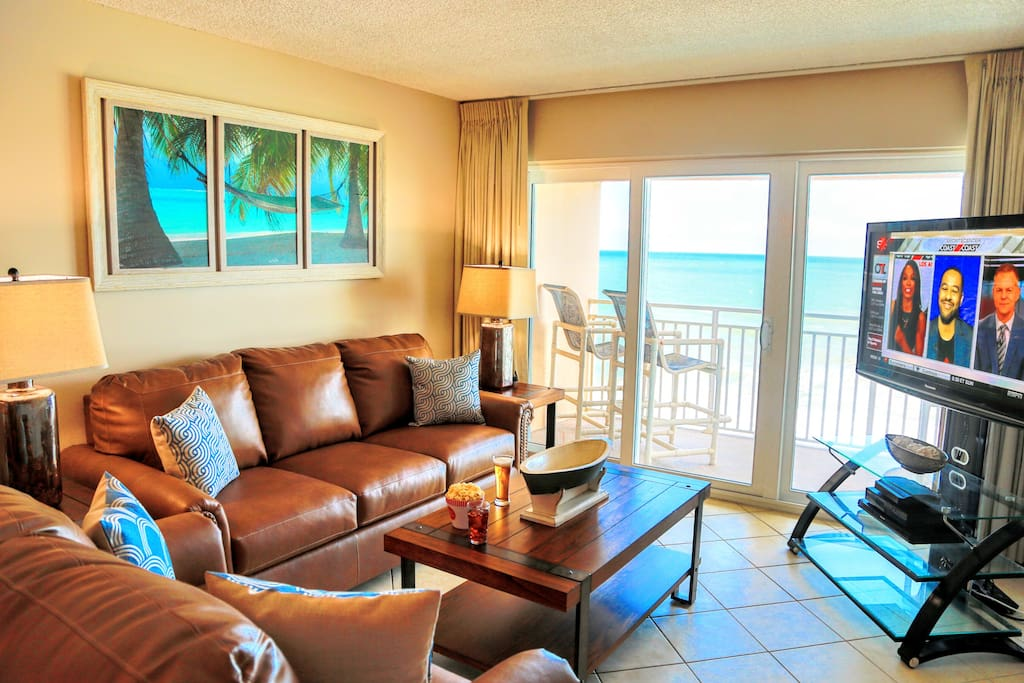 """Family room features breathtaking oceanfront views, 55"""" TV, & a queen sleeper"""