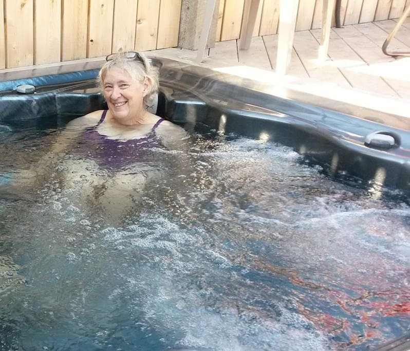 Your hostess, Donna, soaking in the hot tub on the middle deck.