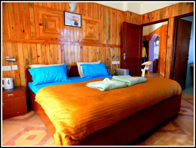 Our rooms- with a double bed, modular wardrobes, a coffee table, an attached big washroom and heaters to keep you cozy :)