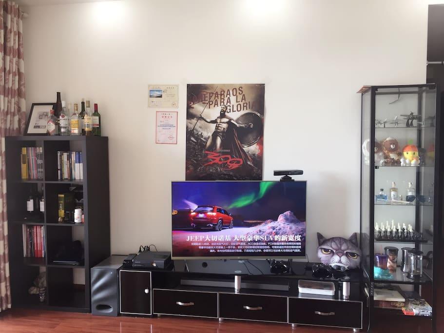livingroom photo1:客厅阳光充足,阳台视野极佳适合观景。设施包括智能电视、空调、WiFi、家用游戏机XBOX等。