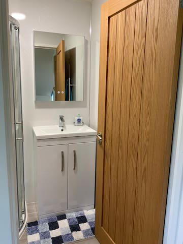 New en suite with shower toilet wash hand basin. Electric shaver point and light around mirror