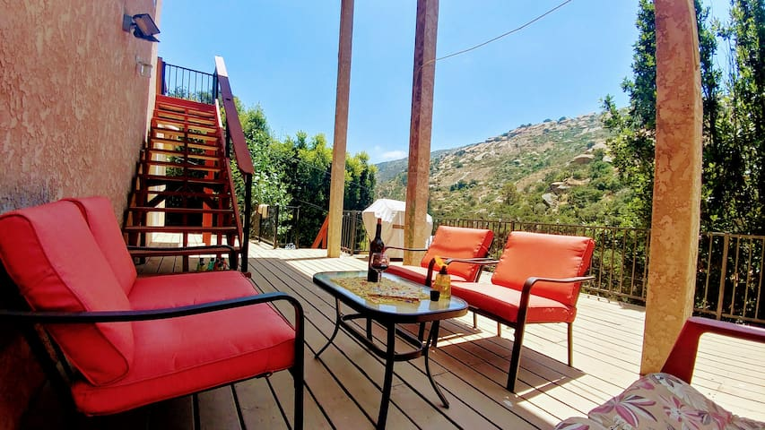 Seating area with views of the hills.  Relax with a glass of wine!