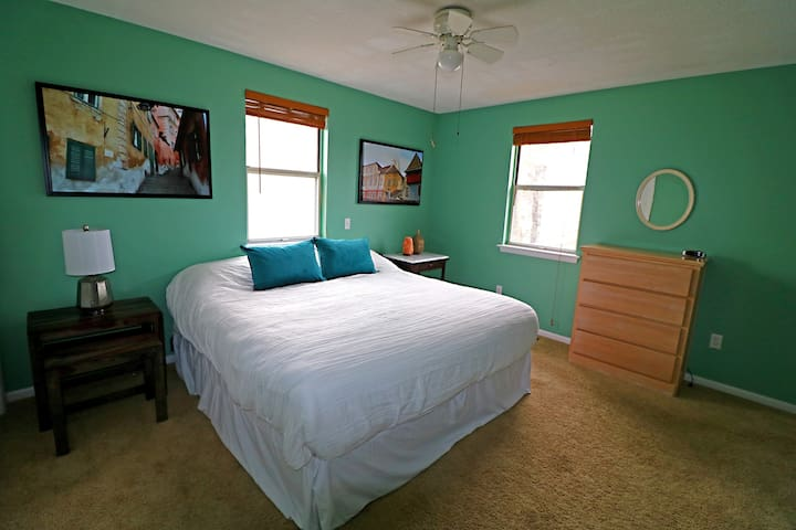 Bedroom 1: Features a King Bed and Full Private Bathroom