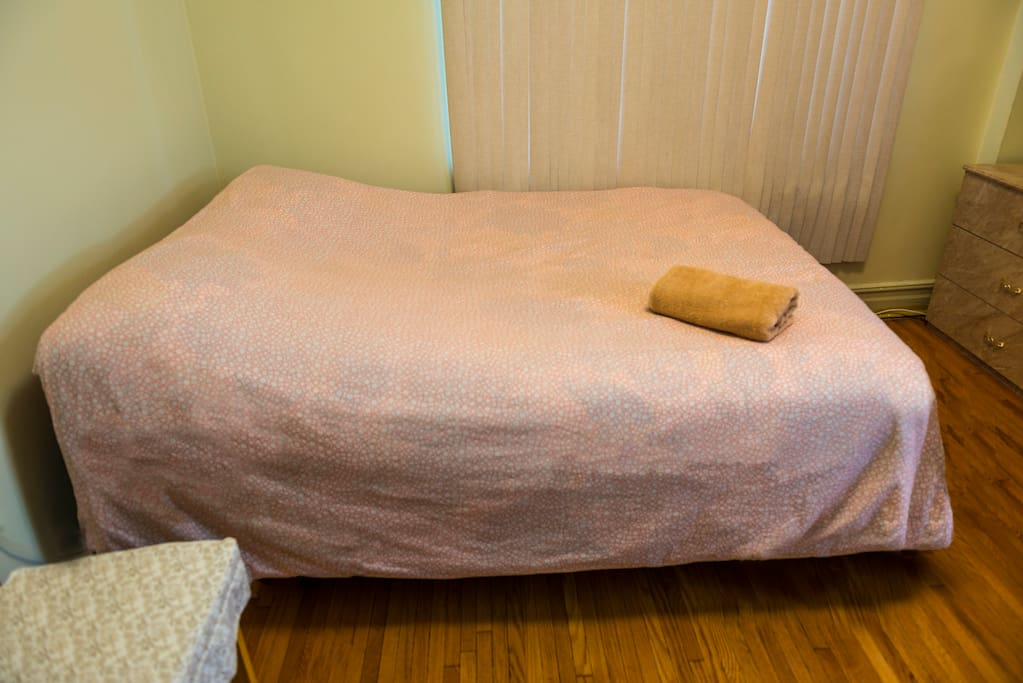 Queen size bed, sleeps two adults comfortably.