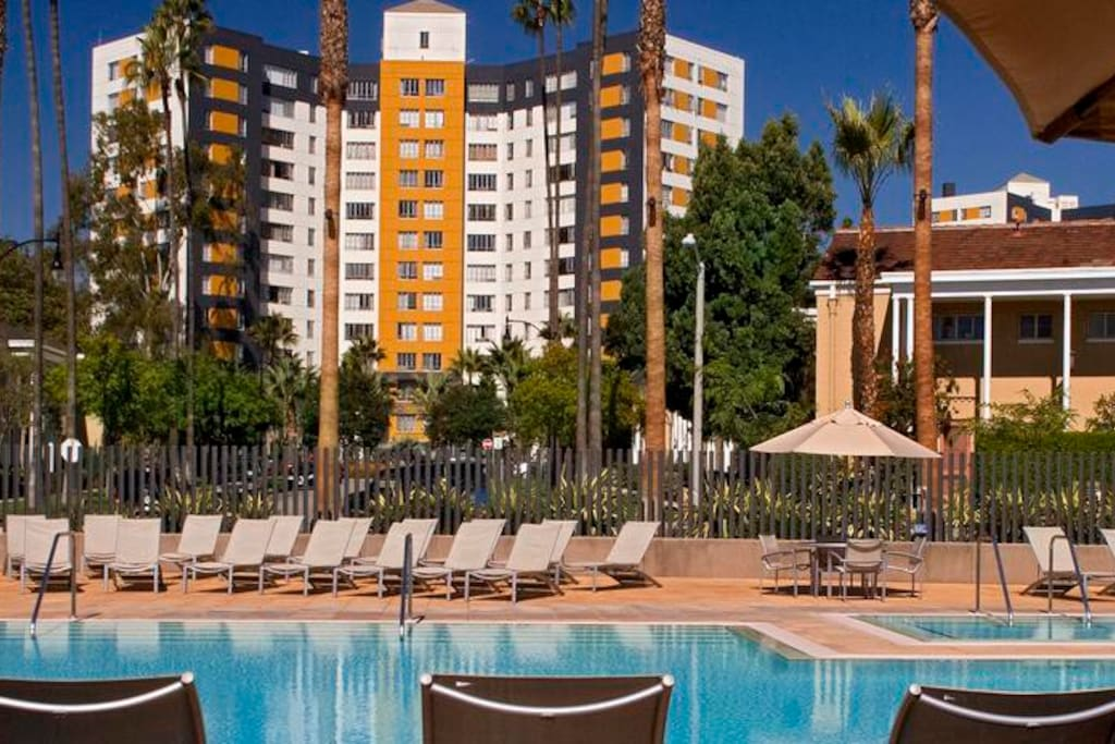 Incredible luxurious community in the heart of LA close to the Best tourist places and just 12 minuets walking to the Groove and Farmers market For long-term tenants there is a membership fee to private community gym and the pool  For visitors  Entry fee is $10/day