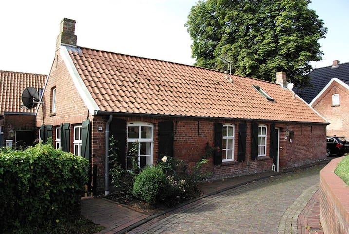 Wohnung in denkmalgeschütztem Friesenhaus - Krummhörn - Apartamento