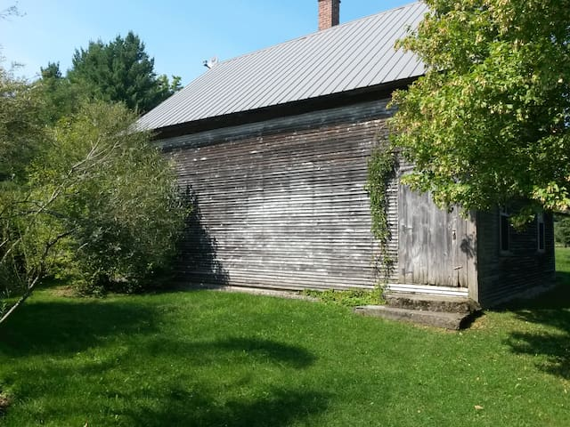 Shed for storing wood and winter gear.