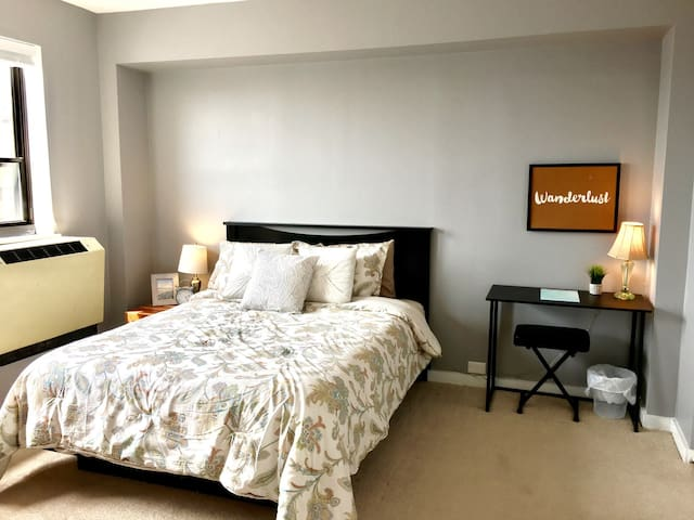 Large one bedroom with comfortable queen bed and study nook.