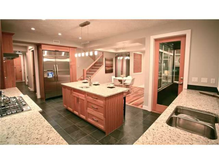 Spacious Modern Kitchen with Great Island for Entertaining and access to large flat backyard