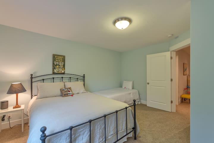 upstairs bed with queen and twin beds