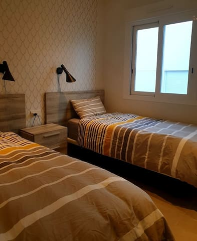 Another picture of the room with 2 single beds and window with double glass