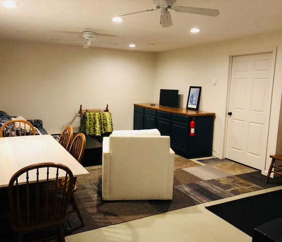 Downstairs den for the kids, gather around the table and play games or enjoy some snacks.