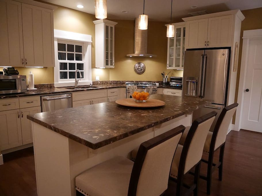 Kitchen - imperial marble countertops, gas range