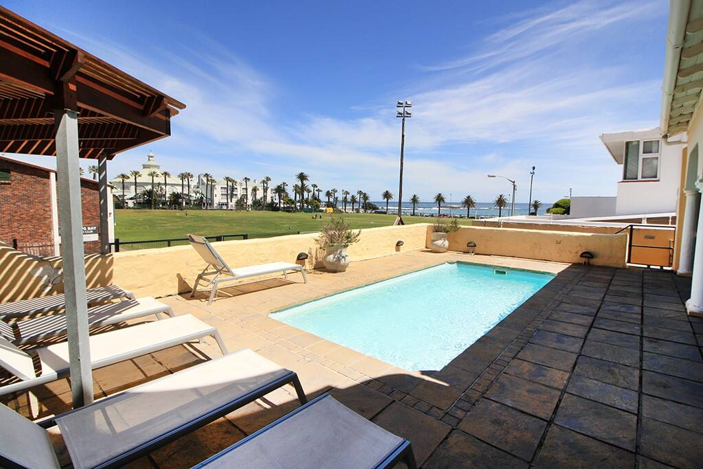 Communal pool area with loungers