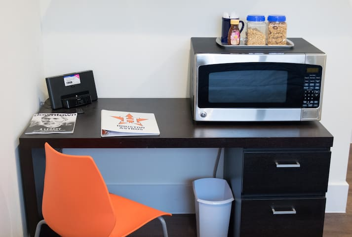 Desk with ihome, microwave and guidebook