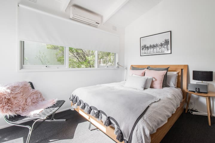 Main bedroom gets the view! Also features reverse cycle heating and cooling