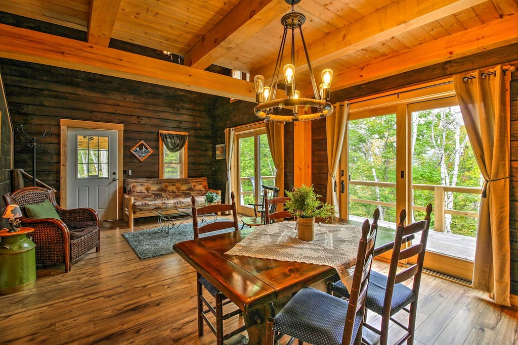Comfortable furnishings and rustic decor flow throughout the cabin.