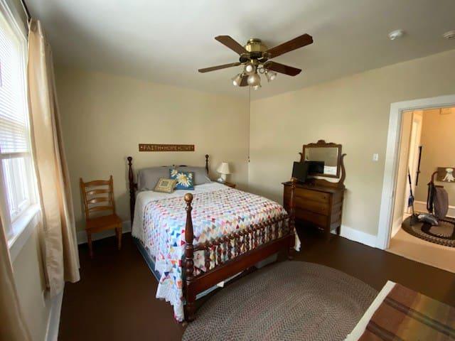Bedroom has door access to hallway and living room.