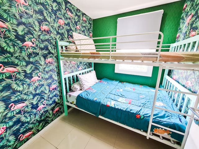 Photo of the second bedroom, consists of 120x200x2 bunk bed, Air Conditioner. Flamingo concept with cozy Bunk Bed. Instagrammable spot.