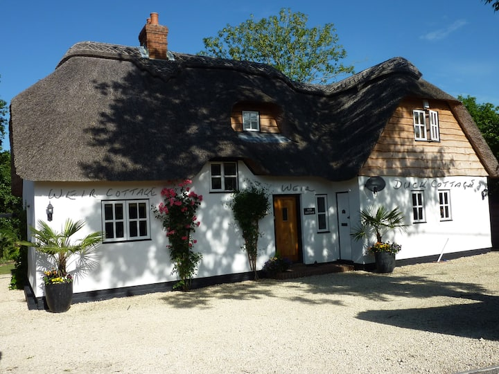 Beautifully Appointed Riverside Thatched Cottage