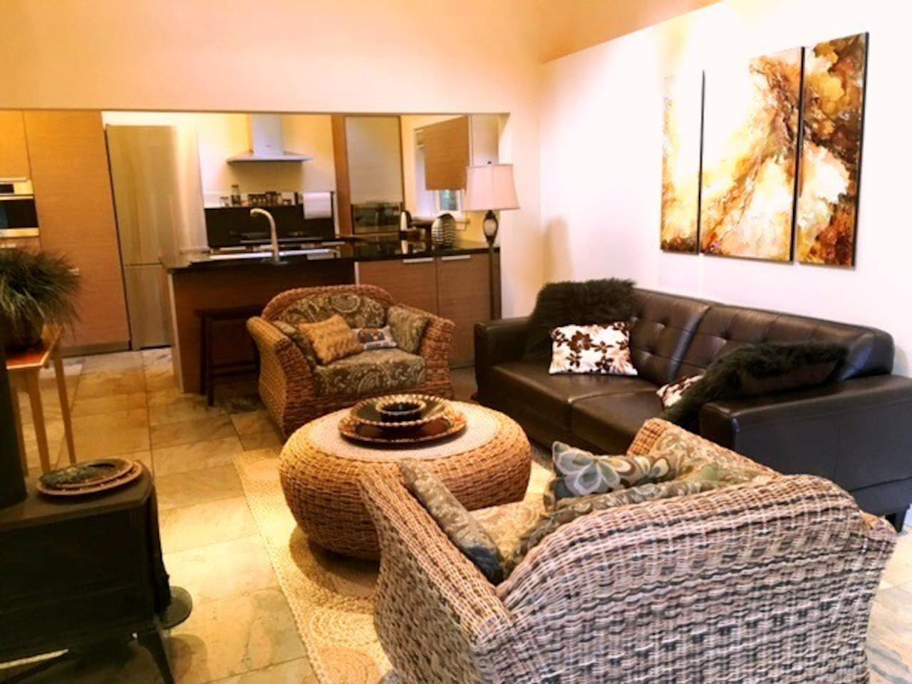 High ceilings, comfortable furnishings and heated tiles in living space.