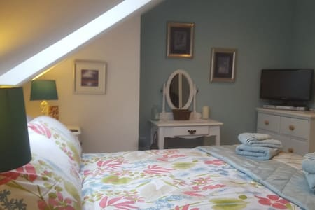 Village life. cosy attic room.with breakfast