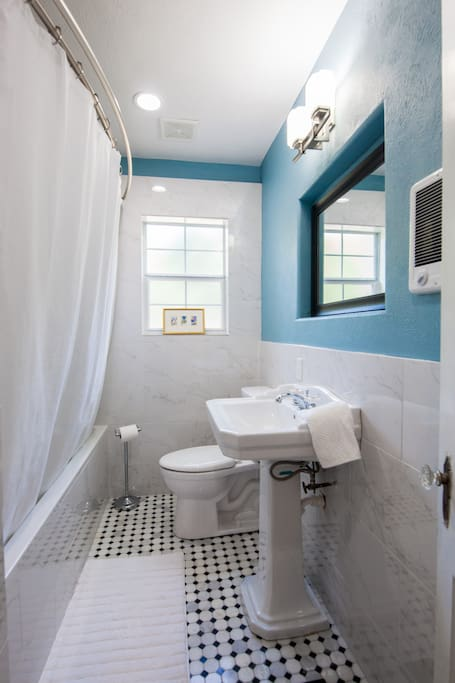 Fully renovated bathroom  with marble tile and huge tub
