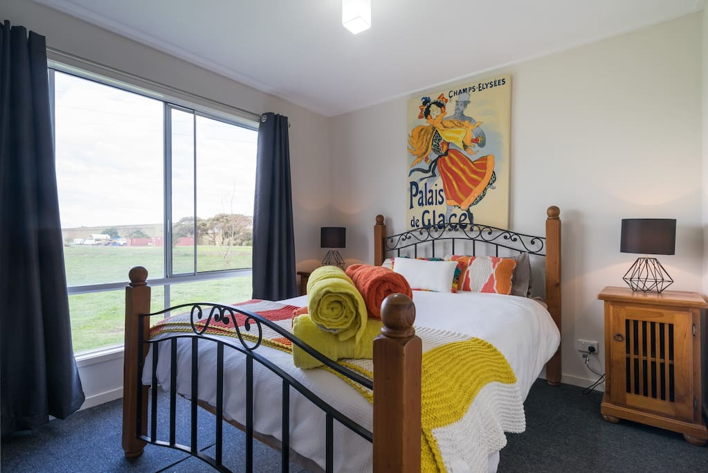 Enjoy a calm and relaxing bedroom that overlooks 8.5 acres