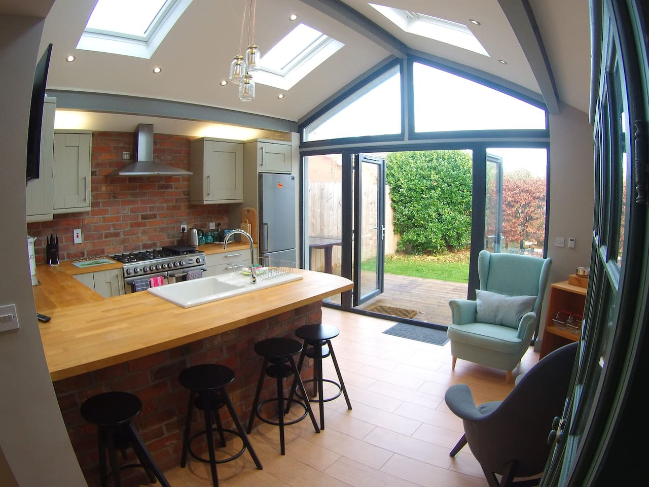 Kitchen & living area leading to sunny private enclosed rear garden...