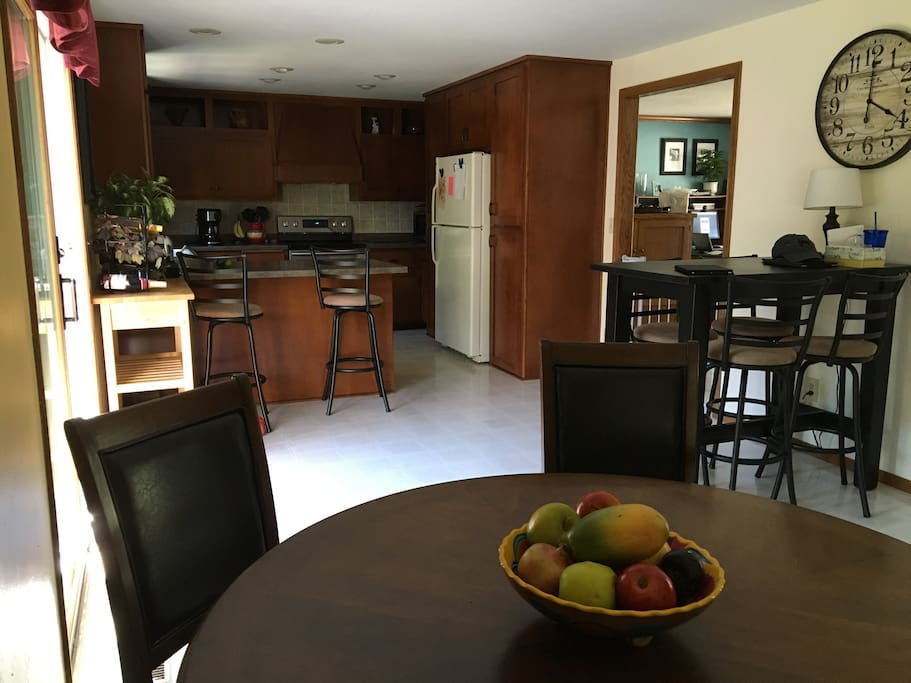 Spacious open concept kitchen, dining, and living area