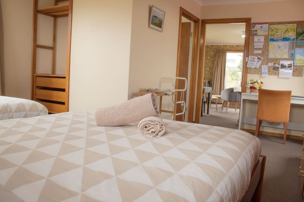 Your own spacious area with two rooms, a bedroom with 1 x queen size and 1 x single bed and separate lounge/dining area.