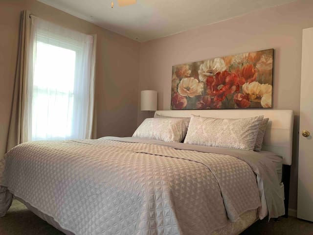 Featuring master bedroom with a king size bed