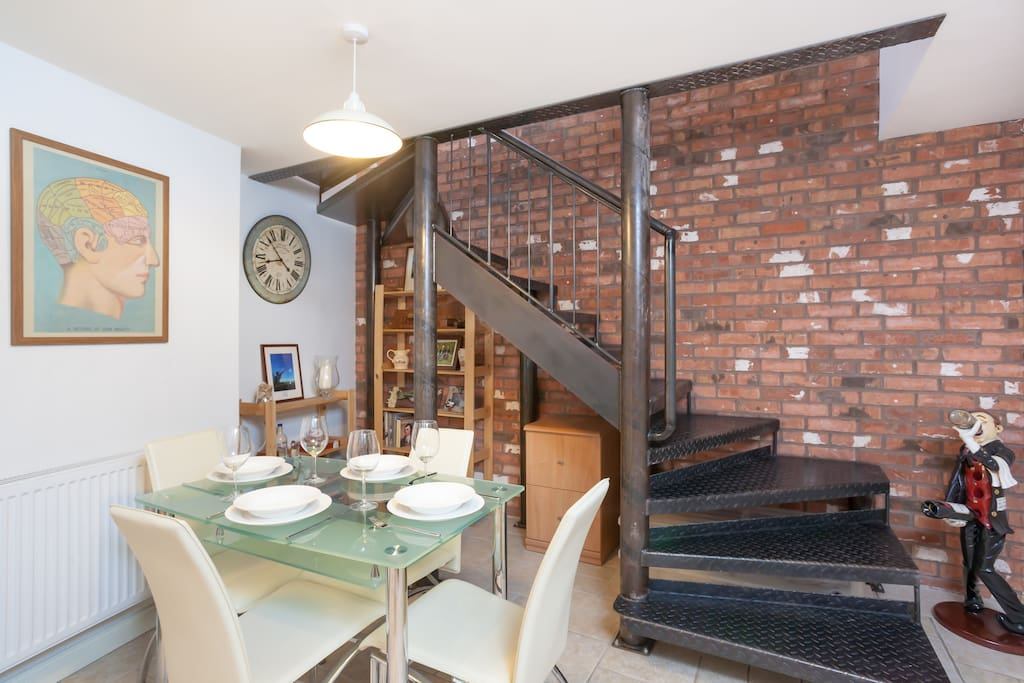 Stylish & comfortable dining area downstairs is perfect for socialising, working or keeping the cook company. Includes all cutlery & crockery for an enjoyable dining experience
