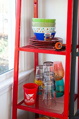 Bowls, glasses, and plates so you can eat microwaved meals and have a glass of soda.