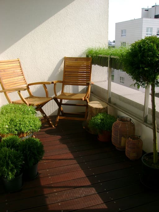 balcony with 2 garden chairs (sorry no plants during winter)