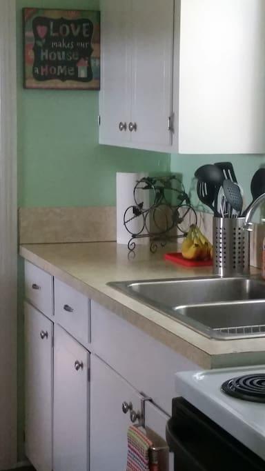 Kitchen with coffee, tea, sugar & cream