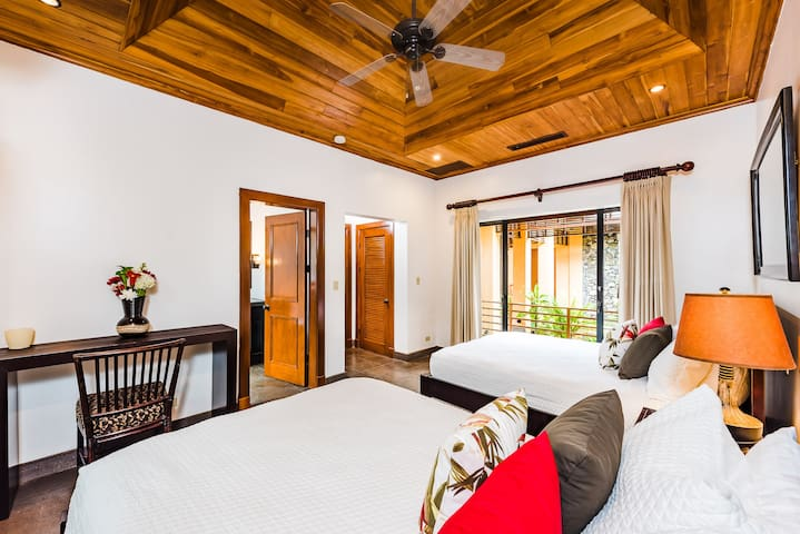 Ensuite Bedroom with two queen beds to share the adventure with family and friends
