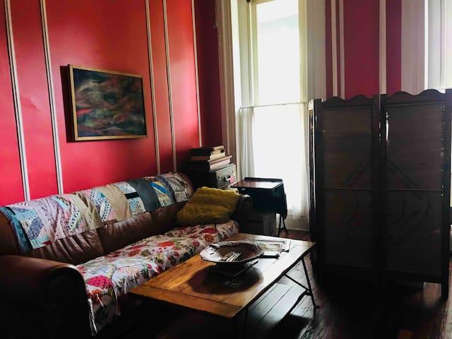 Leather sofa, floor to ceiling windows.