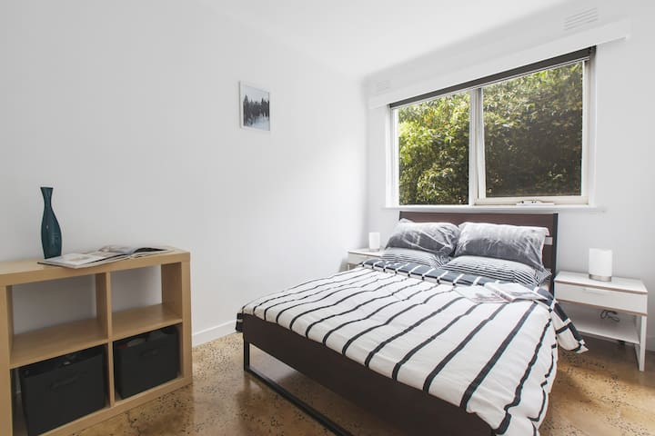 A second bedroom is furnished with a double bed and has ample storage; as well as sheer and black-out blinds