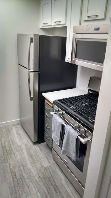 Modern kitchen appliances.  Icemaker in fridge.
