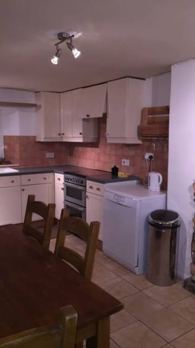 Fully equipped kitchen with dishwasher, gas cooker, fridge freezer and washer dryer.