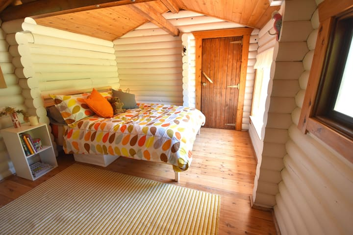 Double bed in separate sleeping cabin.