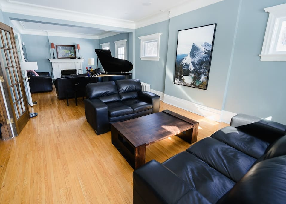 Living room complete with grand piano.