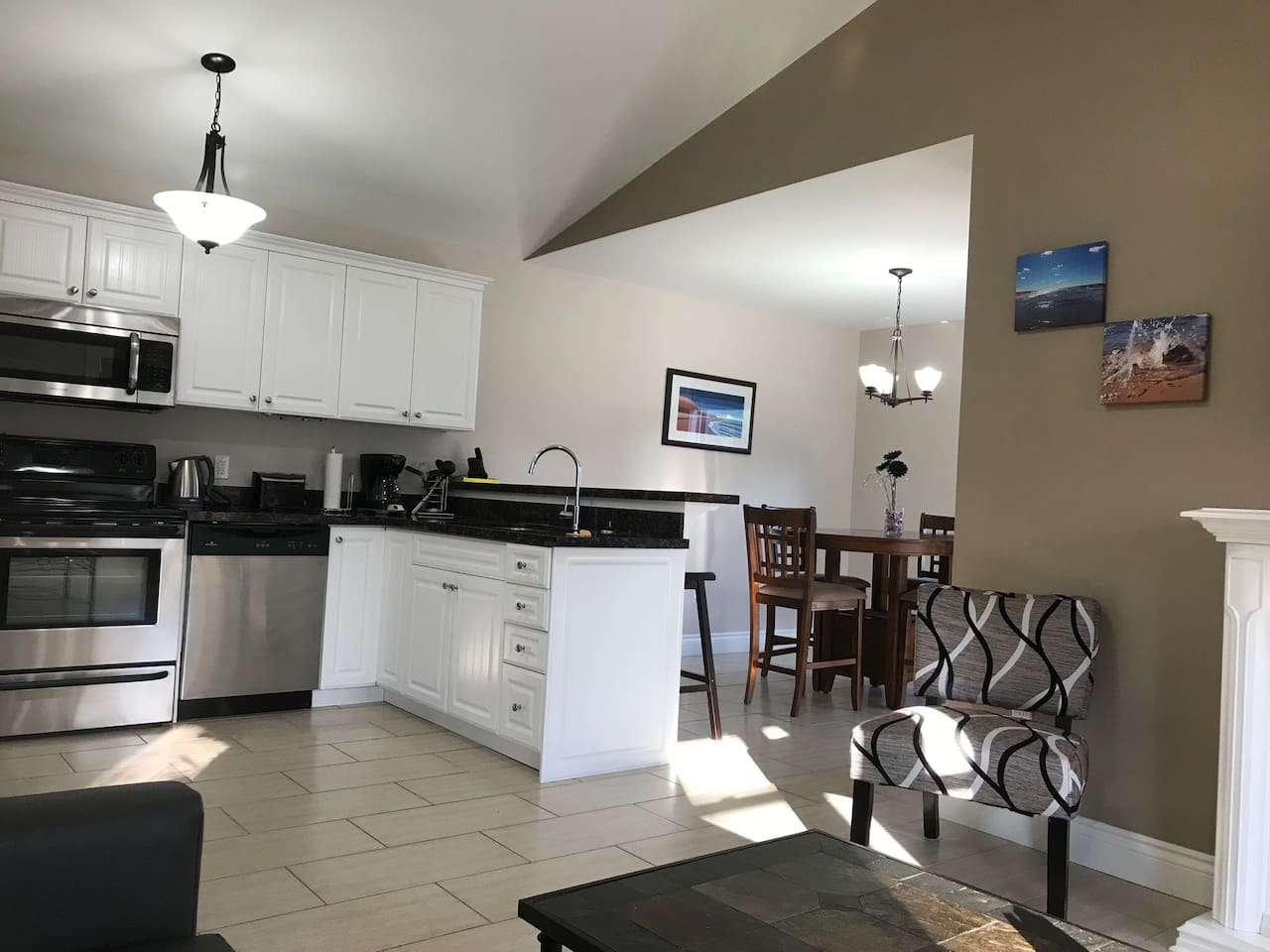 Kitchen, dining, living area, open concept. Patio doors open from the dining room.