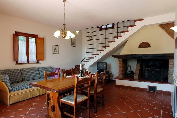 Villetta con 2 camere e giardino privato