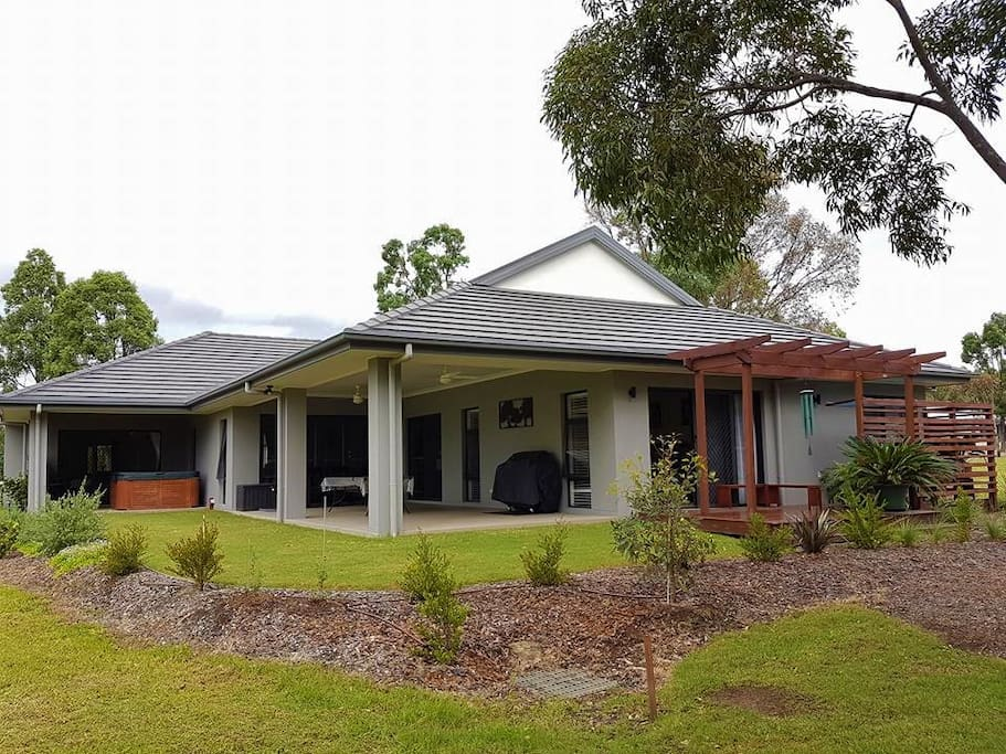 View from the back of the house - 2 bedrooms each have a verandah plus one large entertainers verandah, with BBQ.