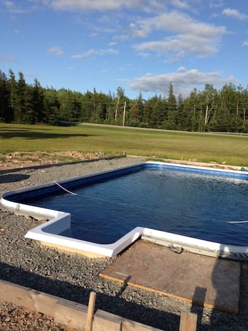 Ground around pool not quite finished but the water is perfect!